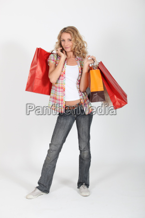 woman smiling with shopping bags