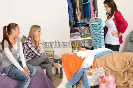 young girl showing shirt friends after