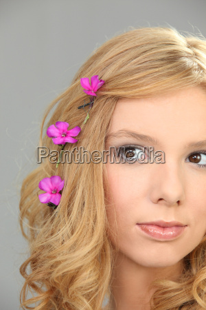 young woman with pink flowers in