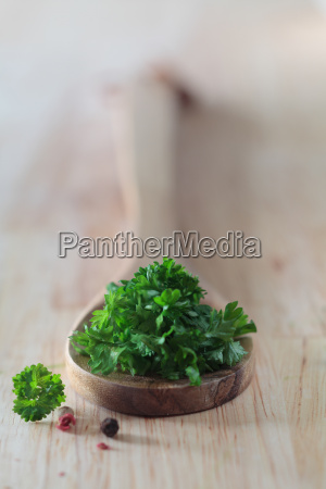 fresh parsley leaves on a wooden