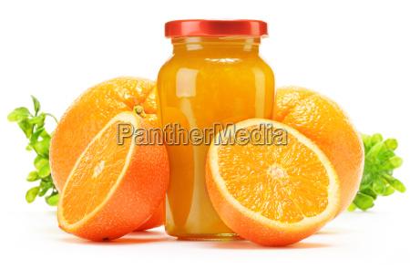 glass and jug of orange juice