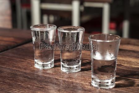 shot glasses of vodka on a