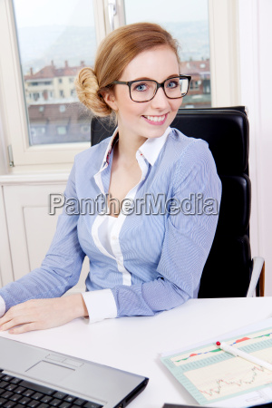 young blonde woman works in a