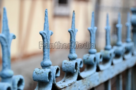 a fence made of metal in