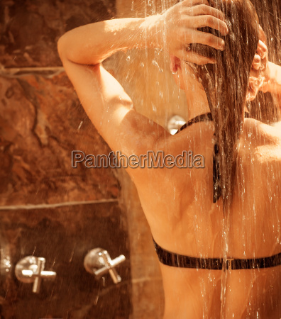 pretty woman taking shower