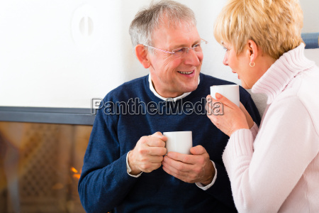 retirees at home in front of