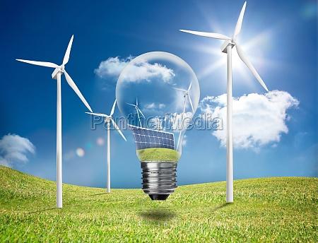 four wind turbines in a field