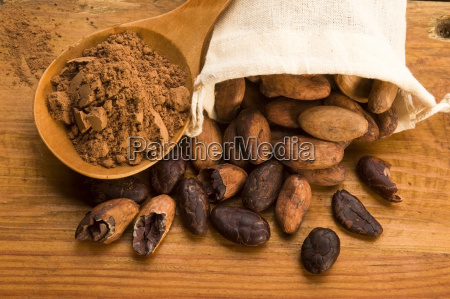 cocoa cacao beans on natural wooden