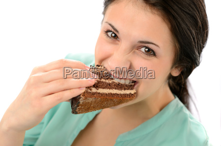 greedy young woman eating tasty cake