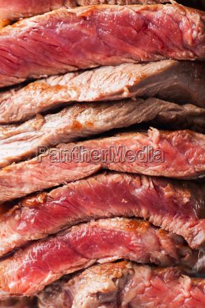 sliced u200bu200bsteak on a meat fork