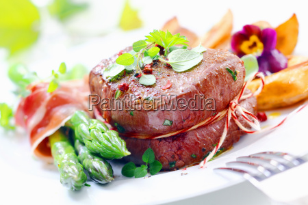 thick juicy steak with fresh green