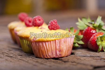 four strawberry rhubarb raspberry muffins