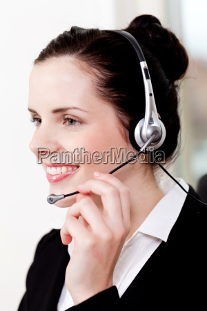 young brunette woman working in a