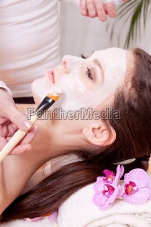 young brunette woman with a nourishing