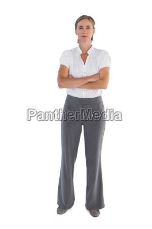serious businesswoman standing with her arms