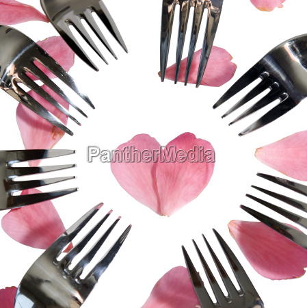 forks surrounding heart shape and rose