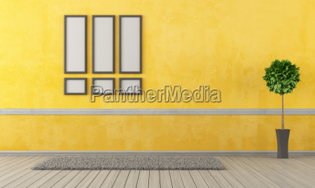 empty yellow living room with carpet