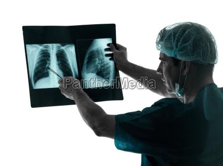 doctor surgeon radiologist examaning lung torso