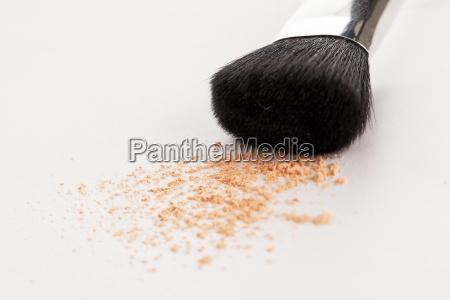 makeup natural brush with beige powder