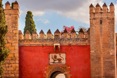 red front gate alcazar royal palace