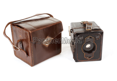 very old vintage camera on white