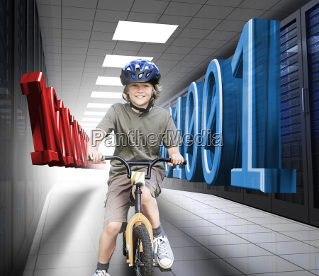 happy boy on a bike in