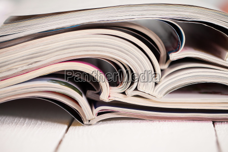 pile of colorful magazines on a