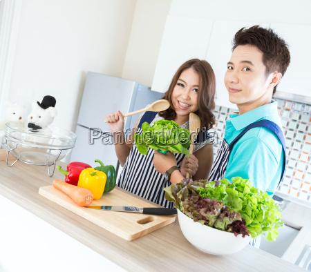 couples in modern kitchen