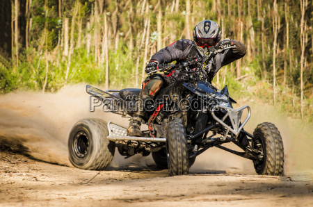 atv racer takes a turn during