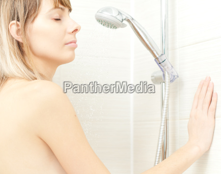 young girl taking shower