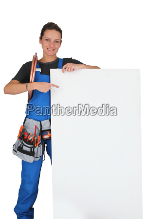 woman pointing at blank board with