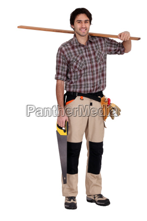 carpenter with saw and plank of