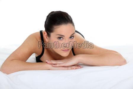 woman lying on a bed in