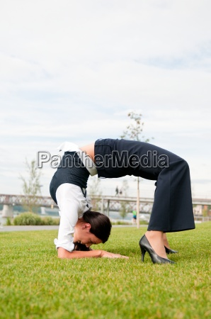 flexibility business woman outdoors