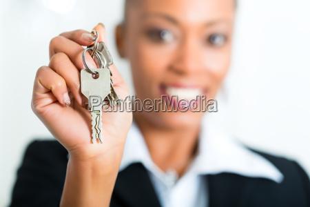 young broker hands over the keys