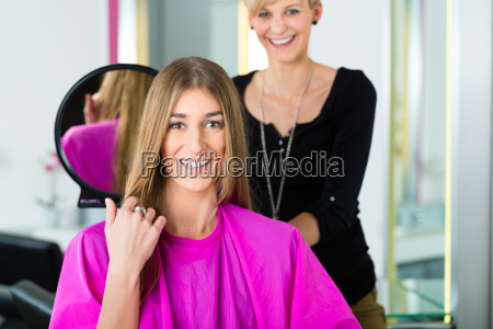 woman at the hairdresser with advice