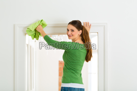 woman doing spring cleaning