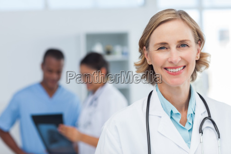 woman doctor smiling and looking to