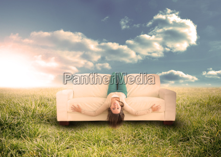 silly woman sitting upside down on