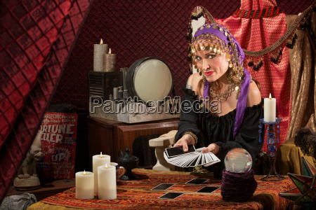 sly lady with tarot cards