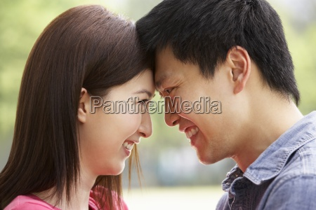 portrait of young chinese couple looking