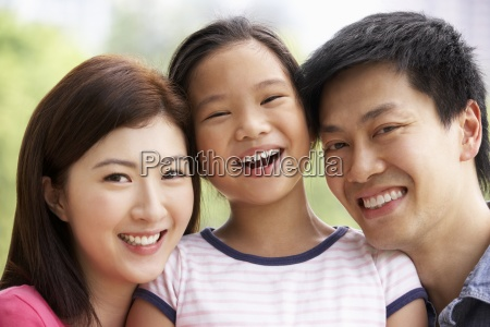 portrait of chinese family with daughter