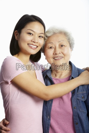 studio portrait of chinese mother with