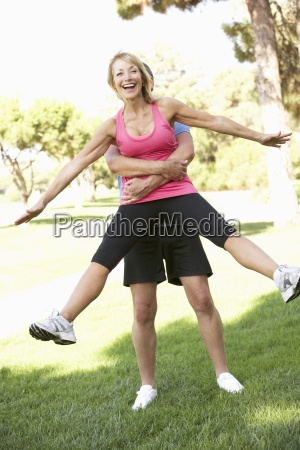 senior man lifting woman during excercise