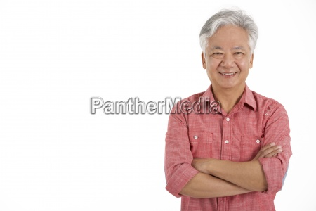 studio shot of chinese senior man