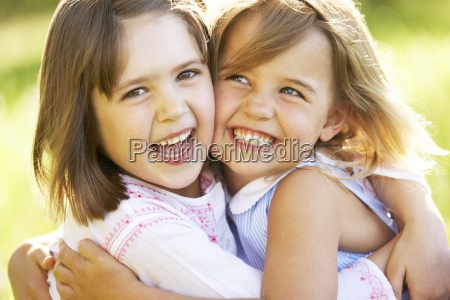two young girls giving one another