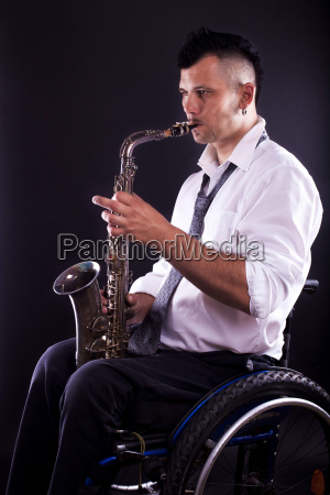 wheelchairs playing saxophone