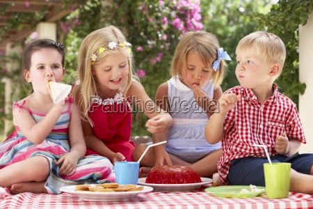 group of children eating jelly at