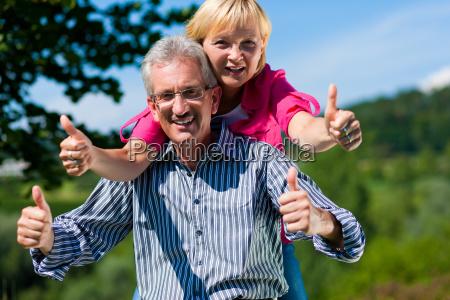 happy senior couple on walk