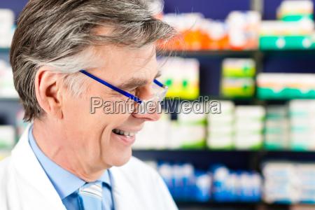 pharmacist with medicine in pharmacy